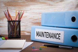 Maintenance, Office Binder on Wooden Desk