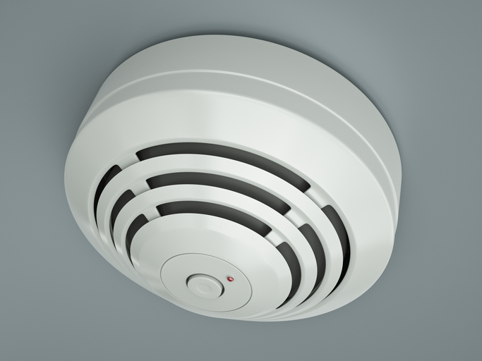 Smoke detector attached to the ceiling. 3D rendered illustration.