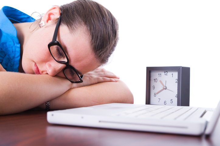 Young brunette business woman sleeping at work.