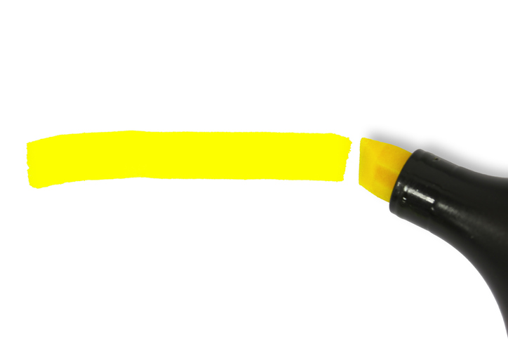 Macro picture of a yellow highlighter on white background.