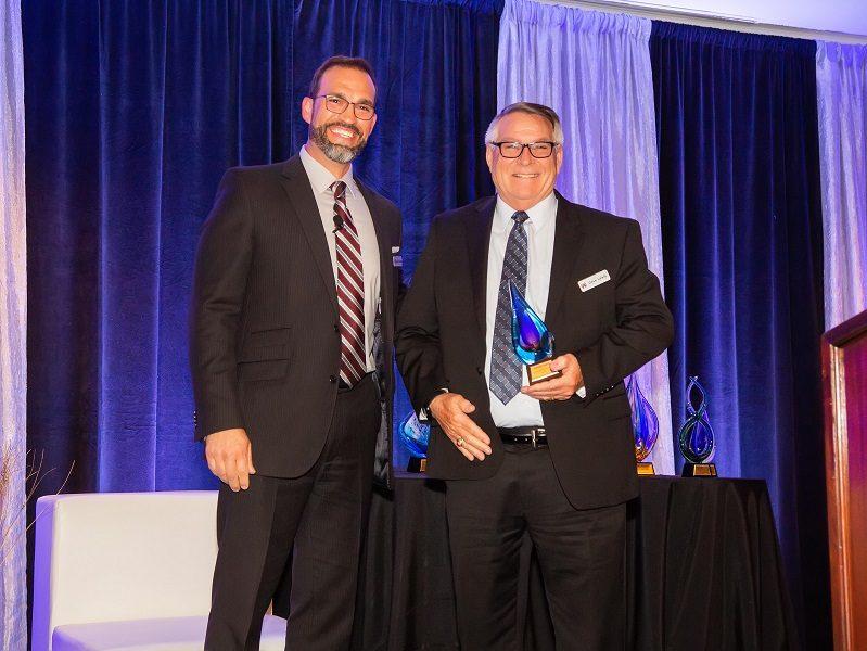 dave lewis receiving award