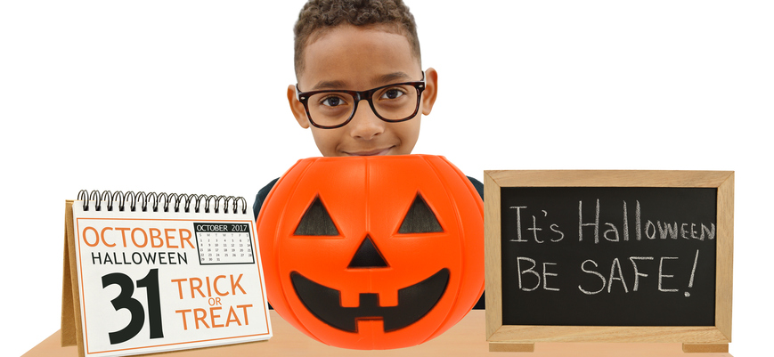 Halloween pumpkin, calendar, safety blackboard boy looking at camera white background