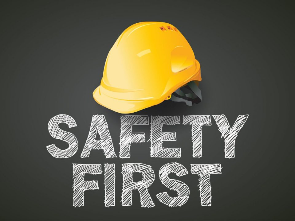 hard hat with safety first text overlaid