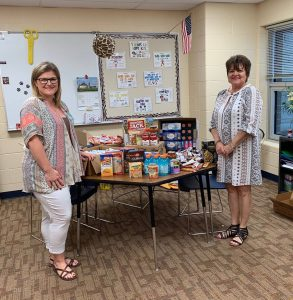 two employees with the food they collected