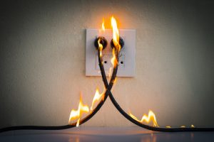 property management electrical safety plug on fire